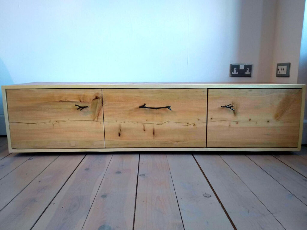 solid TV unit with 3 natural effect doors