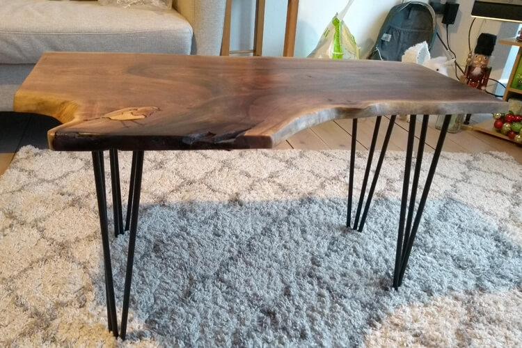 side view of solid walnut coffee table with hairpin legs