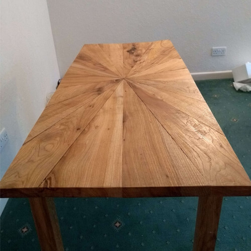 top view of sunburst style dining table